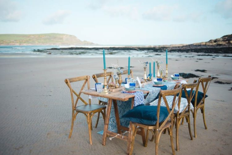 The wedding tablescape was right on the beach, with bold and catchy shades of blue and cool prints
