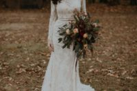 09 a lace sheath wedding dress with long sleeves, a high neckline and a sash plus statement earrings