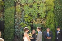 09 a living wlal of sucuclents and air plants for a lush outdoor and even tropical forest feel at the wedding