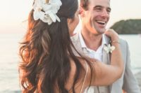 09 a wavy half updo with dimension and white orchids for a tropical beach bride