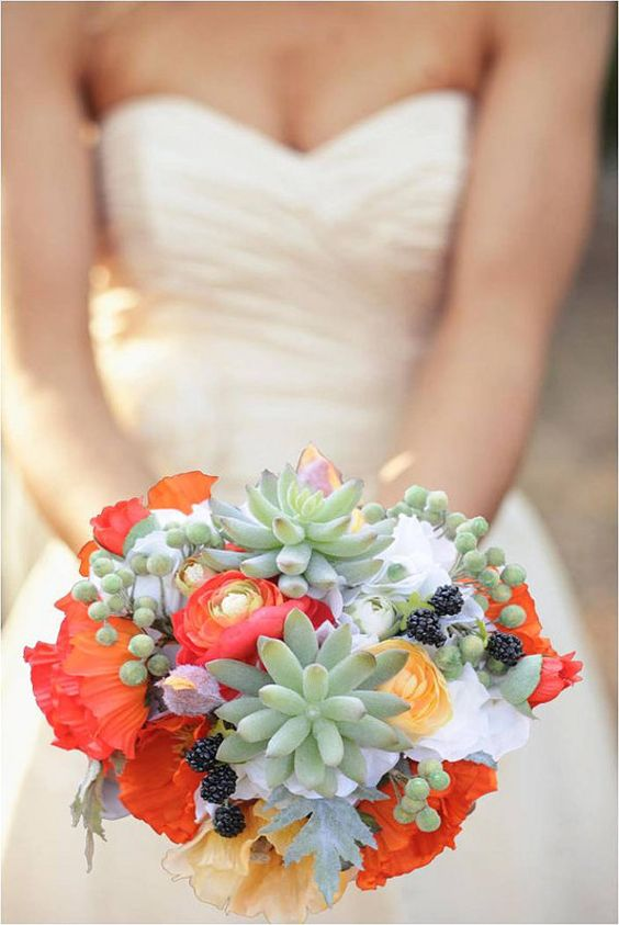a wedding bouquet with succulents, berries, orange and red blooms for a summer bride