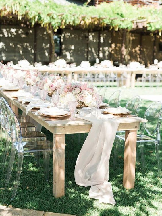 airy off-white table runners and blush and neutral blooms for centerpieces for a romantic summer wedding