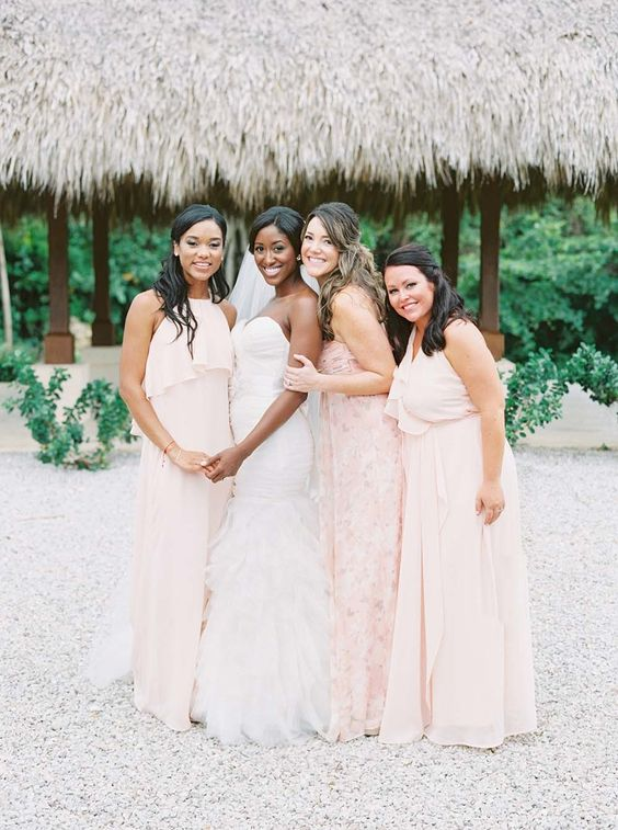 mismatched blush bridesmaids' dresses and a blush floral print one for the maid of honor