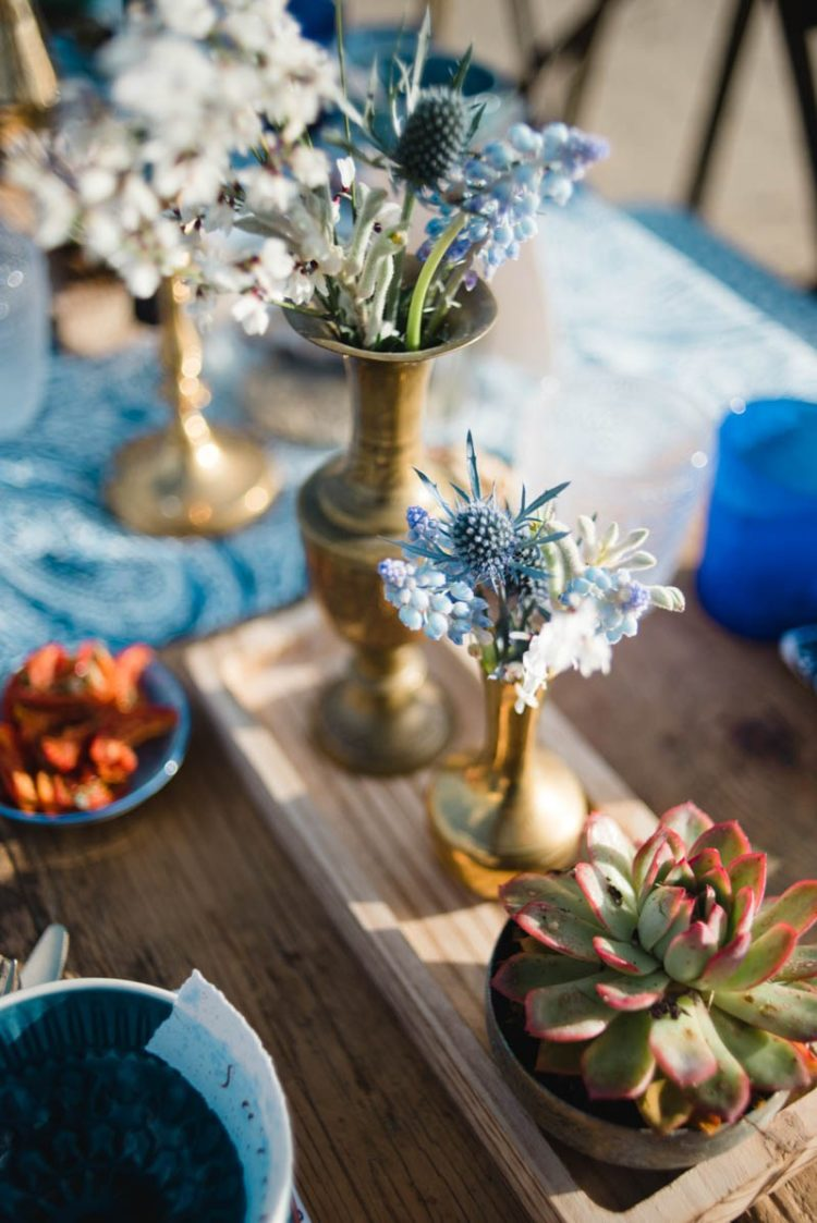 Beautiful blue and white blooms and succulents were used for table decor to give it a coastal feel