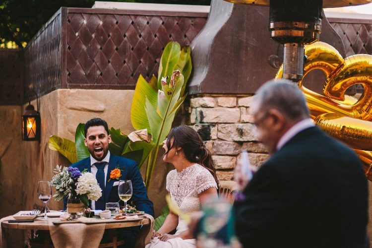 The reception tables were decorated with simple blooms and neutral textiles, and the couple decided on some balloons for decor