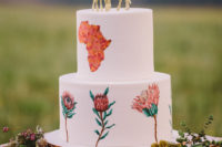 10 The wedding cake was with handpainted king proteas, African continent and gold giraffe cake toppers