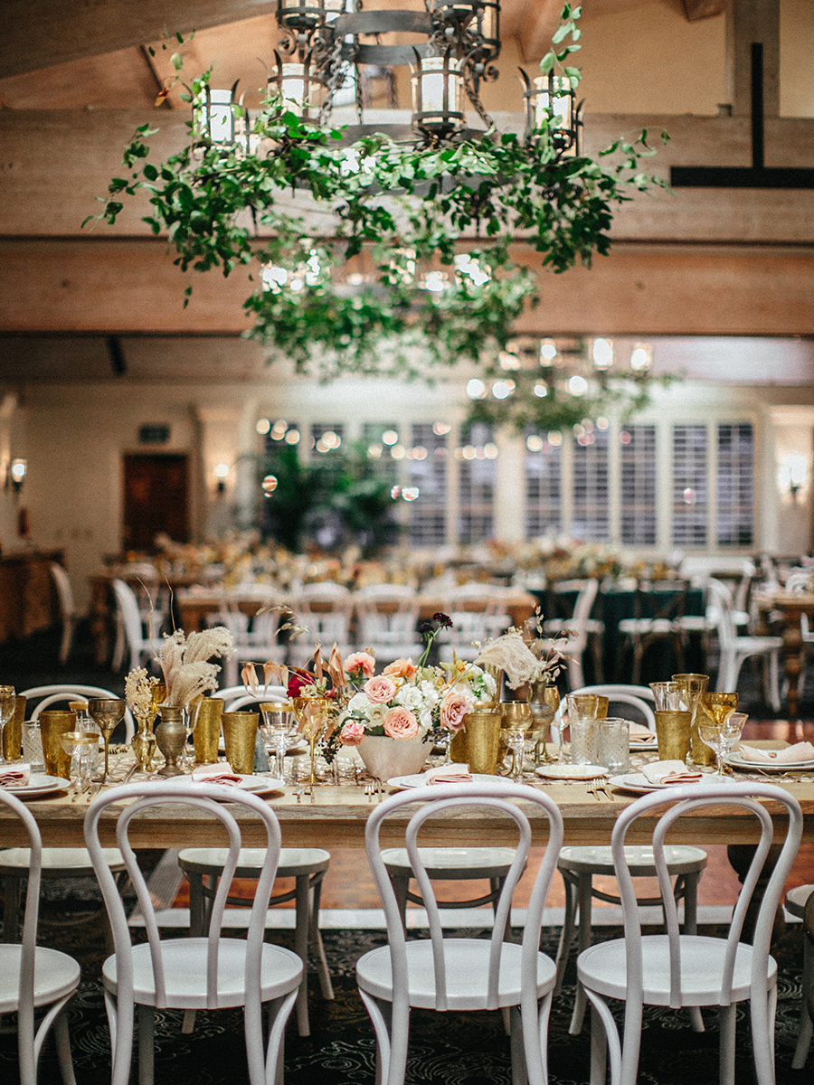 The wedding venue was decorated with greens, delicate florals and gilded touches