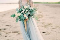10 a beautiful wedding bouquet with white blooms, eucalyptus and blue thistles