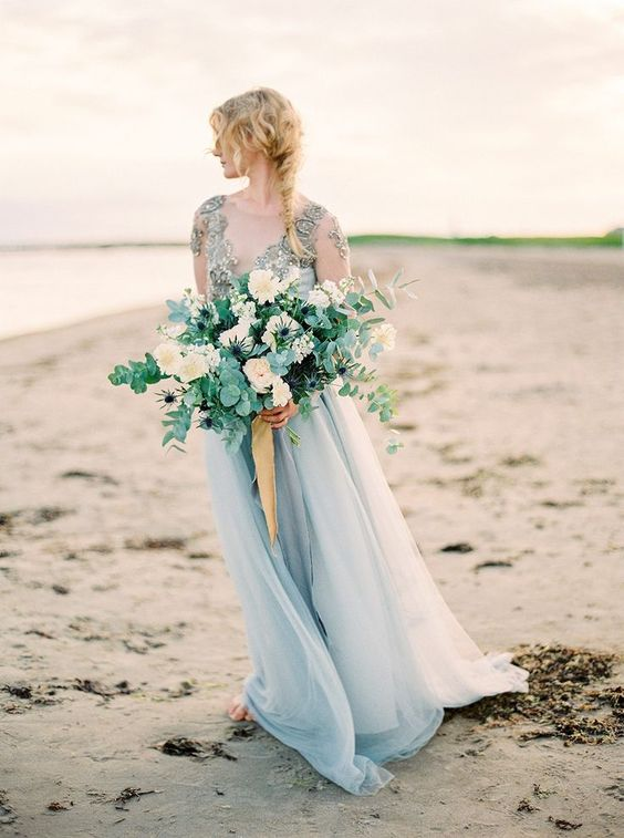 a beautiful wedding bouquet with white blooms, eucalyptus and blue thistles