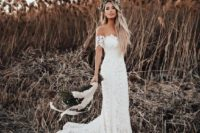 10 a boho lace off-the-shoulder wedding dress with a train is ideal for a boho chic bride