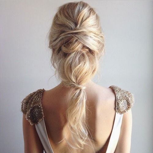 an effortlessly chic textural ponytail with several twists looks very soft and romantic