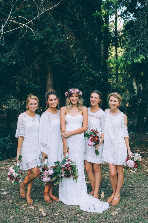 mismatched mini white dresses with various necklines and detailing but with a strong boho folk feel