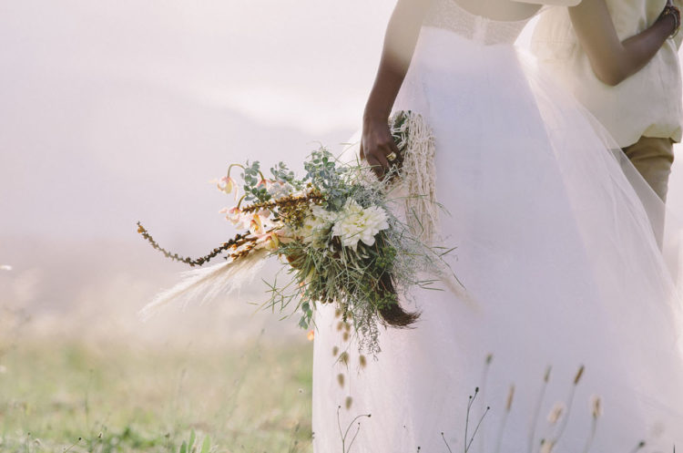 The bridal bouquet was done with air plants, succulents, herbs and feathers