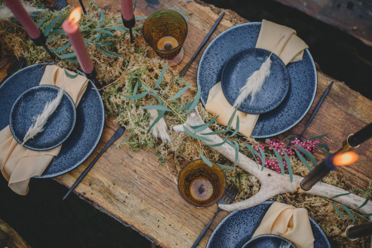 The table runner was of moss and dried herbs, plus candles and antlers