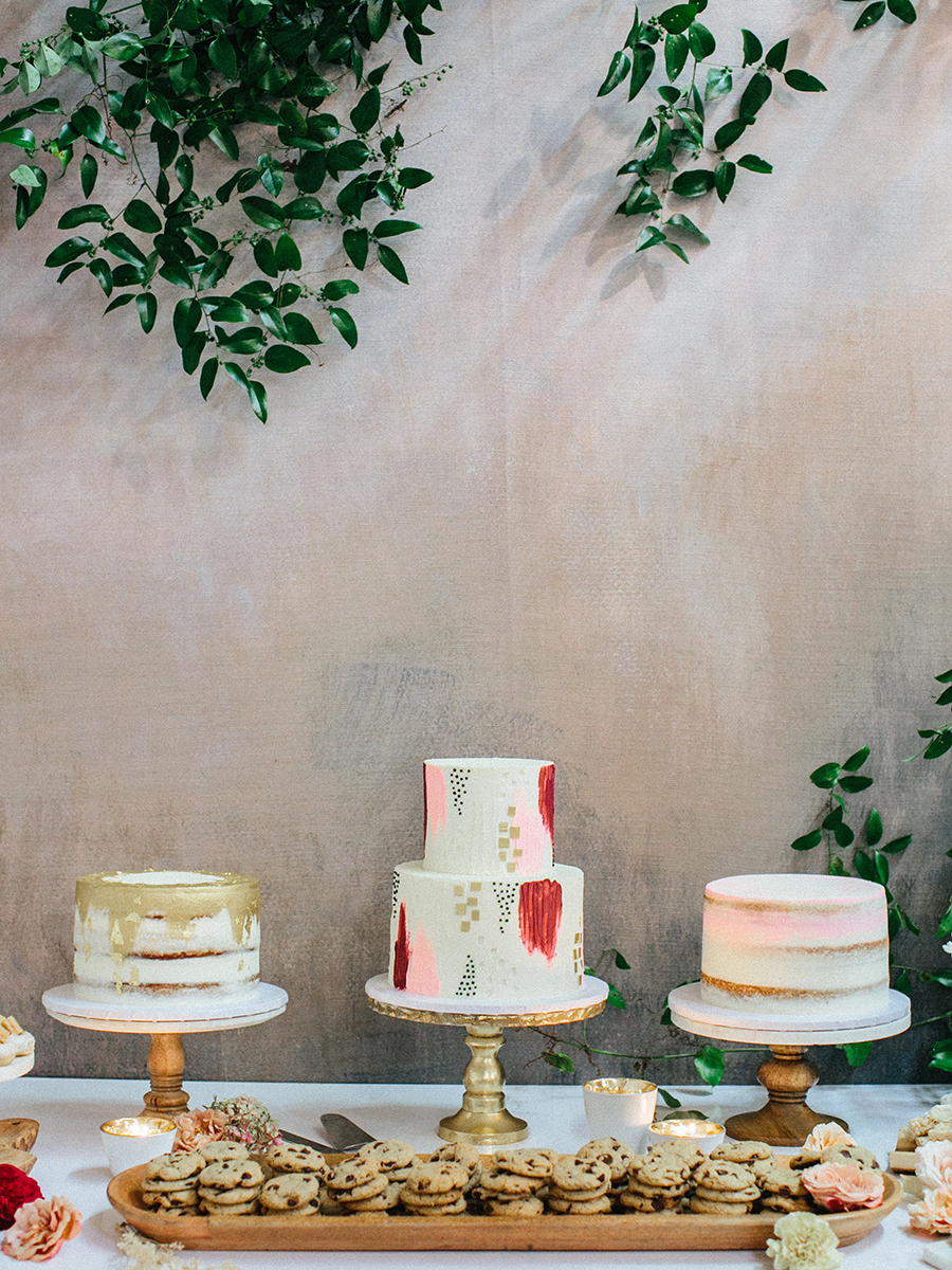 There were three wedding cakes, two nakes ones and a buttercream brushstroke one