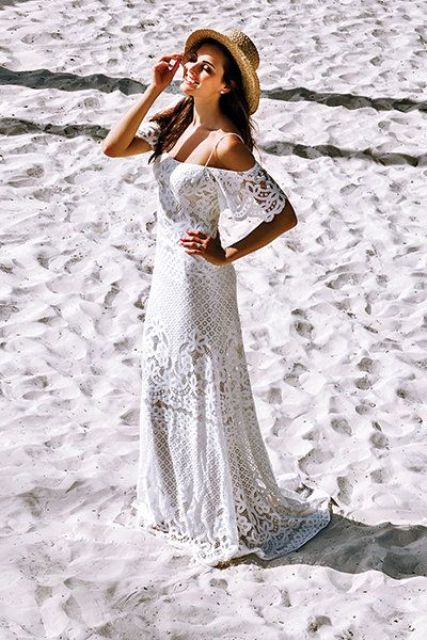 a boho lace sheath wedding dress with an off the shoulder neckline and spaghetti straps