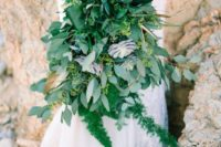 a fantastic lush wedding bouquet of various succulents, ferns and eucalyptus and much more for a tropical bride