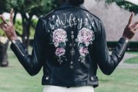 11 a hand painted leather jacket in black is a gorgeous feminine statement