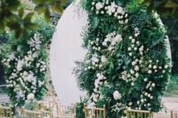 11 a round white backdrop with lush greenery and white blooms is a unique modern idea to make the space edgy