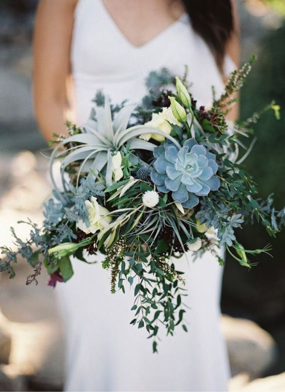 a textural modern bouquet of much greenery, air plants, succulents and white blooms