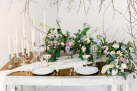 12 The bridal table setting was done with candles, fresh blooms in mauve, lilac and white