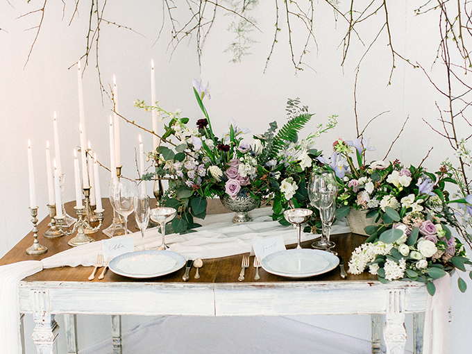 The bridal table setting was done with candles, fresh blooms in mauve, lilac and white