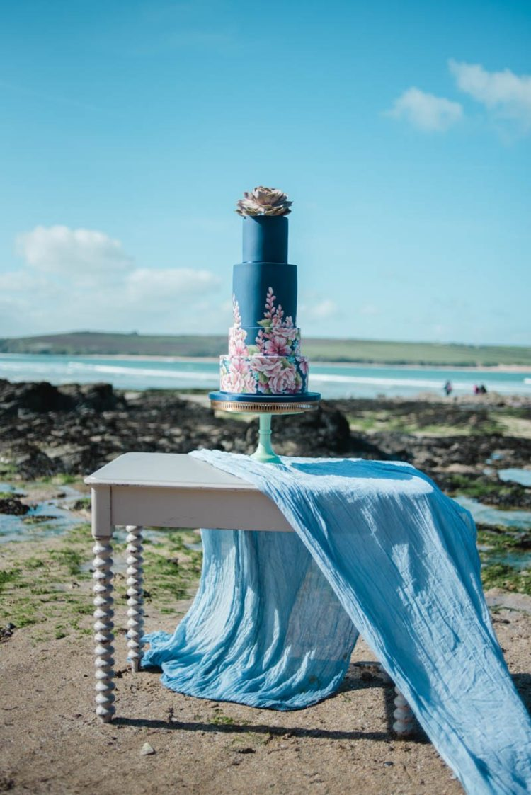 The wedding cake was a navy one, with handpainted florals, a succulent on top and blue fabric