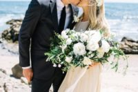 12 a chic white bloom and lush greenery wedding bouquet with white ribbons