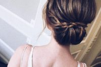 12 a low updo with a braided halo and some locks down can be worn with long or medium-length hair