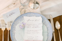 13 The wedding chargers were blue ones, and look at this refined flatware