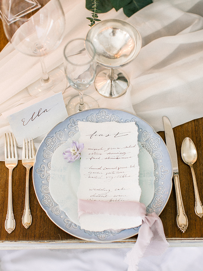 The wedding chargers were blue ones, and look at this refined flatware