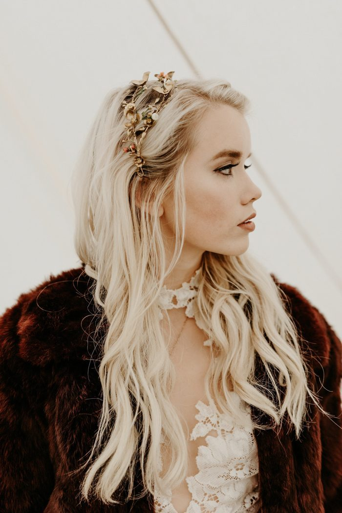 a catch floral bridal tiara that matches the faux fur coat for a boho bride