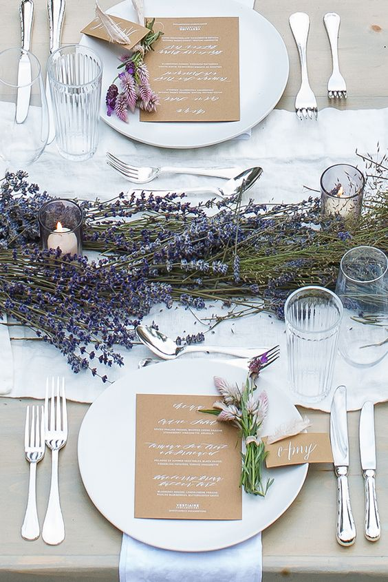 a chic lavender table runner with candles incorporated - you won't need any floral centerpieces