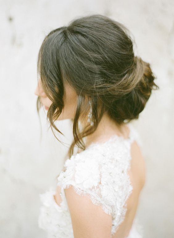 a dimensional low bun and some waves down for a timelessly elegant look