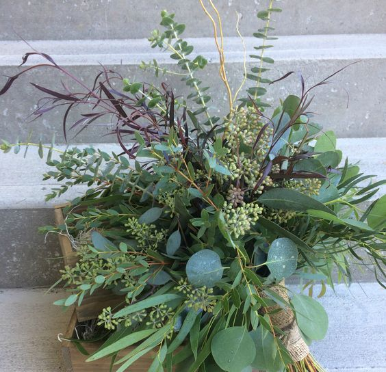 a foliage wedding bouquet with some colroful herbs and a burlap wrap