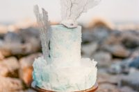13  a gorgeous textural watercolor aqua wedding cake with a sugar shell, pearls and corals