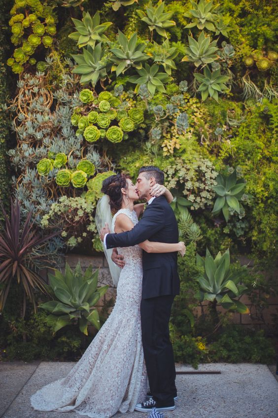 a real living wall with moss, succulents and herbs us a gorgeous wedding backdrop idea