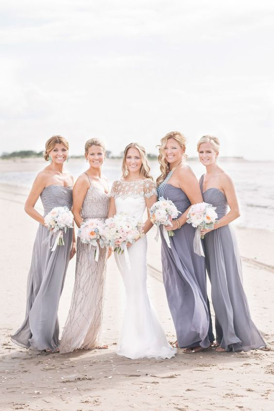 grey strapless and one shoulder maxi dresses for the bridesmaids and an embellished dress for the maid of honor