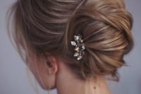 13 one more catchy idea of a messy chignon and twists and locks down and a small rhinestone hairpiece