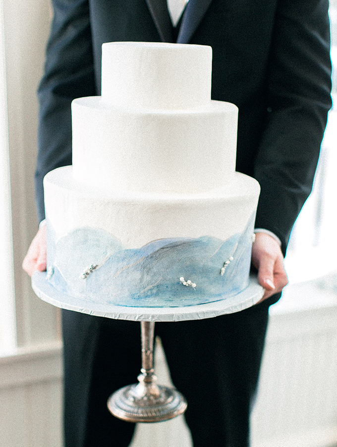The wedding cake was a painted watercolor one, inspired by winter