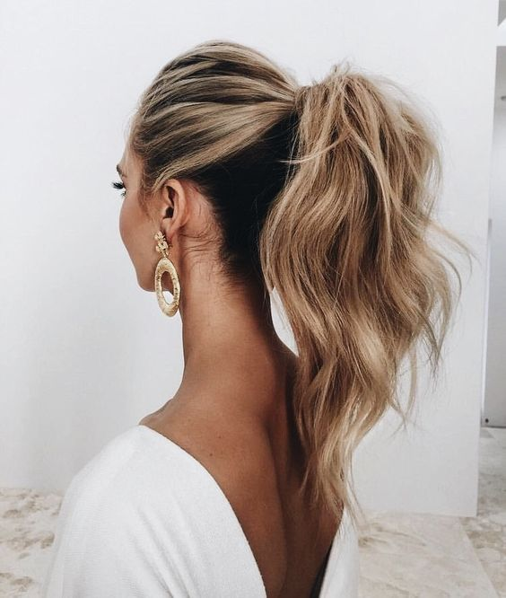 a casual low ponytail with volume on top, texture, dimension and some waves is ideal for a boho or modern bride