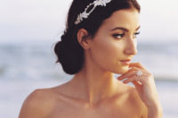 a low braided bun with a gorgeous sparkling headpiece with pearls and rhinestones
