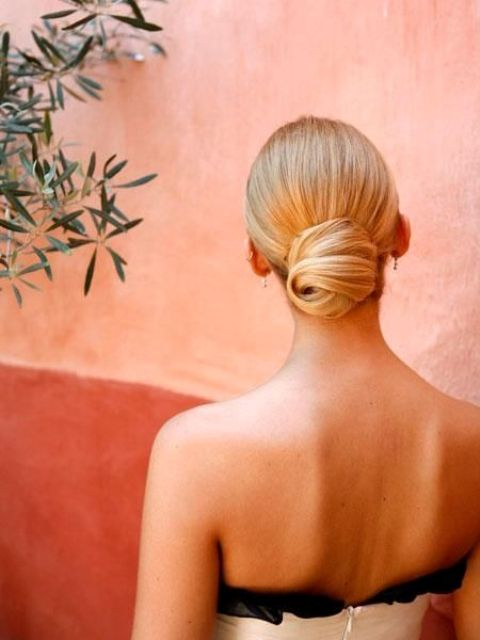 an elegant sleek low bun with a twist is a chic idea and will bring a elegant flavor