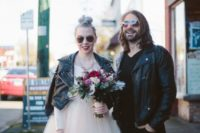 14 the bride in a black leather studded jacket and the groom in a black leather jacket too