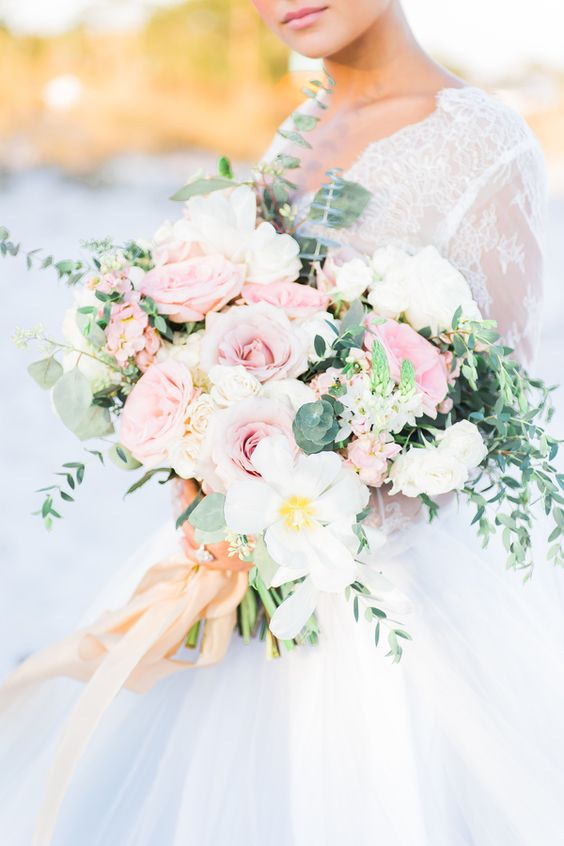a large and lush bouquet with white and pink blooms and eucalyptus for a pastel touch