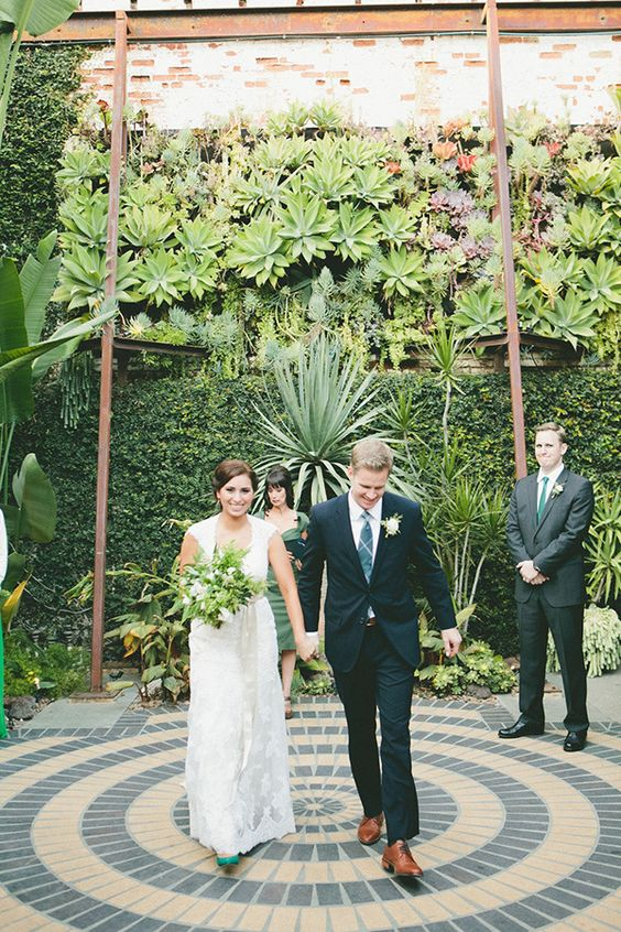 a real living wall of greenery, succulents and air plants for a gorgeous outdoor wedding backdrop