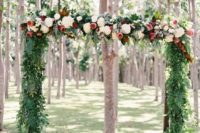 15 a tropical wedding arch with greenery, pink proteas and white blooms