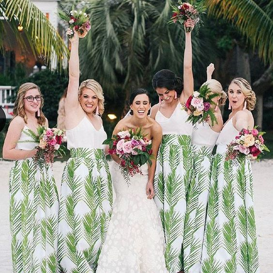 tropical beach bridesmaids' separates with white spaghetti strap tops and maxi leaf print skirts
