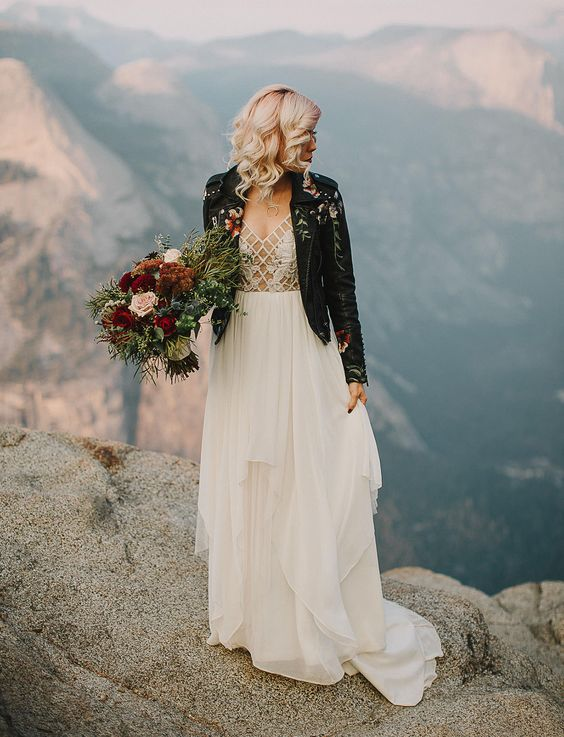a bold semi sheer wedding dress and a handpainted black leather jacket for a statement