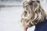 16 a half updo with a bun and waves can be made in a couple of minutes and looks textural